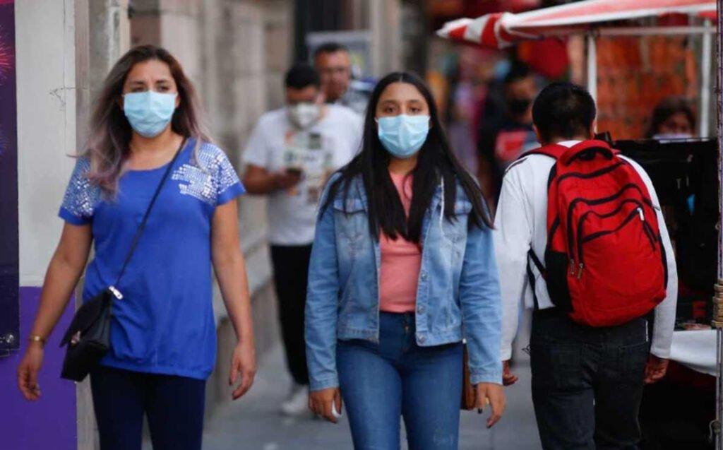 Mujeres con cubre bocas para evitar contagios Covid-19.